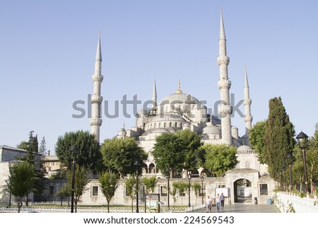 ISTANBUL - JULY 11: Tourists on the square in front of the Blue Mosque on July 11, 2014 in Istanbul. - stock photo
