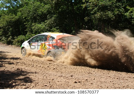 ISTANBUL - JUNE 10: Ali Dinc drives a Ford Fiesta R2 car during 33th Istanbul Rally championship, ISG Stage on June 10, 2012 in Istanbul, Turkey. - stock photo