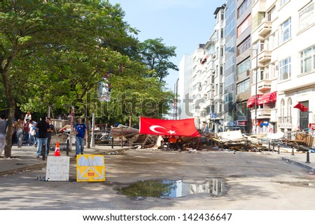 ISTANBUL - JUNE 15: Barricade around Gezi Park during protests on June 15, 2013 in Istanbul, Turkey. Police evacuated Gezi Park by using disproportionate force and clashes until dawn. - stock photo