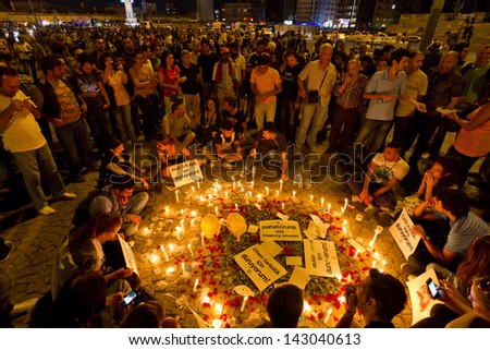 ISTANBUL - JUNE 19: Candles for dead during protests in Taksim on June 19, 2013 in Istanbul, Turkey. Six people died during protests in Turkey - stock photo