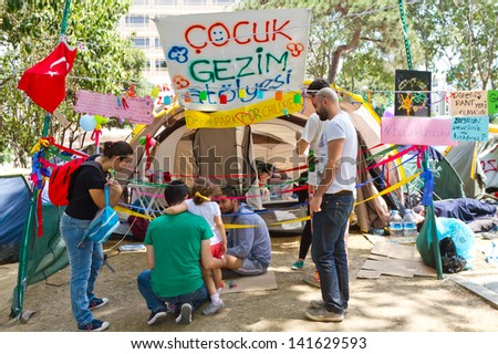 ISTANBUL - JUNE 08: Children workshop tent in Gezi Park on June 08, 2013 in Istanbul, Turkey. Hundreds of people stay in Gezi Parki at night to avoid police intervention. - stock photo