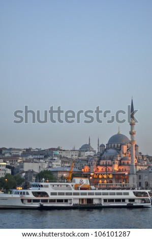 ISTANBUL - JUNE 04: Cruise ferries in Eminonu Port near Valide Sultan Mosque, most famous as Yeni Cami, on June 03, 2012 in Istanbul. Nearly 150,000 passengers use ferryboat daily in Istanbul. - stock photo