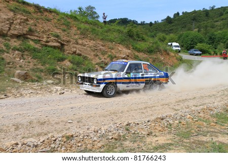ISTANBUL - JUNE 04: Engin Kap drives a 1979 Ford Escort Rs car during 40th Bosphorus Rally 2011 ER championship, Halli Stage on June 04, 2011 in Istanbul, Turkey - stock photo