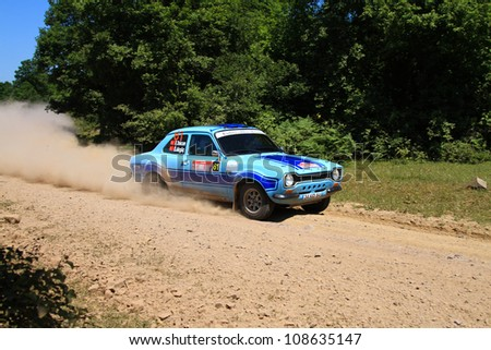 ISTANBUL - JUNE 10: Erdal Tokcan drives a Ford Escort MK1 car during 33th Istanbul Rally championship, ISG Stage on June 10, 2012 in Istanbul, Turkey. - stock photo