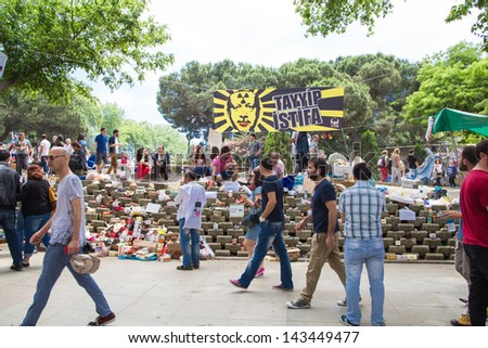 ISTANBUL - JUNE 06, 2013: People in Gezi Park during protests at Taksim Square in Istanbul, Turkey. Protest started 28 May against replacing Taksim Gezi Park to a mall and spread to the country. - stock photo