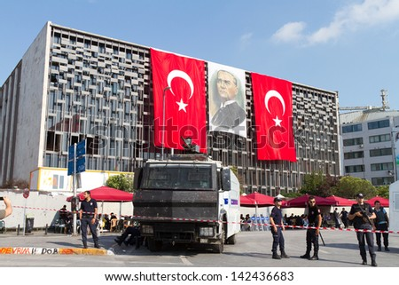 ISTANBUL - JUNE 15: Police force during protests in Turkey on June 15, 2013 in Istanbul, Turkey. Police evacuated Gezi Park by using disproportionate force and clashes until dawn. - stock photo