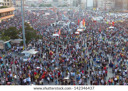 ISTANBUL - JUNE 08: Taksim Square during protests in Turkey on June 08, 2013 in Istanbul, Turkey. One of the most important protest reason is restrictions on freedom of speech. - stock photo