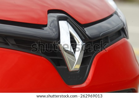 ISTANBUL - MARCH 4: Renault Clio logo on March 4, 2015 Istanbul. Renault S.A. is a French car manufacturer producing cars, vans, buses, trucks, tractors, tanks, autorail vehicles - stock photo