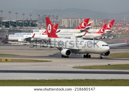 ISTANBUL - MAY 28: A Turkish Airlines Airbus A330 taxis on May 28, 2014 in Istanbul. Turkish Airlines is the largest airline of Turkey with its headquarters in Istanbul. - stock photo