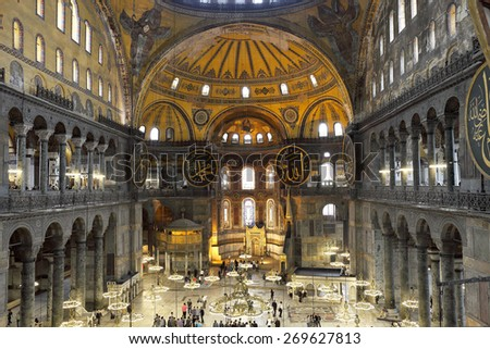 ISTANBUL - MAY 28, 2011: Tourists visiting the Hagia Sophia on may 28, 2011 in Istanbul, Turkey. Hagia Sophia is the greatest monument of Byzantine Culture. - stock photo