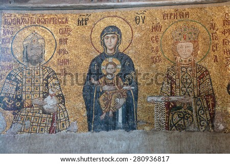 ISTANBUL - MAY 17, 2014 - Virgin Mary and infant Christ child, flanked by Emperor John Comnenus and Eirene Byzantine mosaic in the gallery of  Hagia Sophia  in Istanbul, Turkey - stock photo