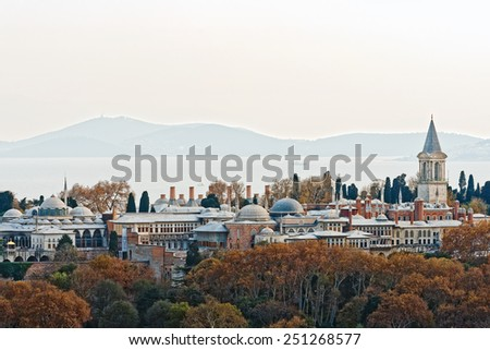 ISTANBUL - NOV 21: Topkapi palace in autumn colors with the Bosphorus in background. November 21, 2013 in Istanbul, Turkey. Construction began in 1459, ordered by Sultan Mehmed II - stock photo