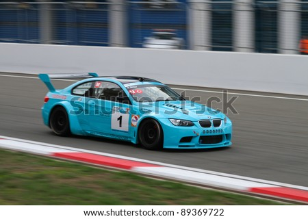 ISTANBUL - OCTOBER 30: Aytac Biter drives a  BMW M3 GT car during Turkey  Track Championship on October 30, 2011 in Istanbul, Turkey - stock photo