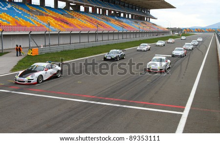ISTANBUL - OCTOBER 30: Cars at start line before Porsche GT3 Cup Challenge Eastern Europe on October 30, 2011 in Istanbul, Turkey - stock photo