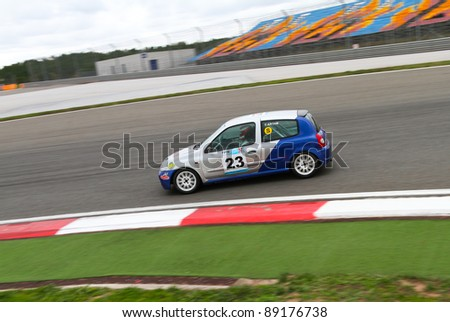 ISTANBUL - OCTOBER 29: Cengiz Artam drives a Renault Clio car during Turkey  Track Championship on October 29, 2011 in Istanbul, Turkey - stock photo