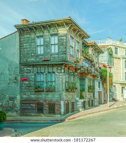 Istanbul street with old traditional wooden houses and filigree sidewalk, Turkey. - stock photo