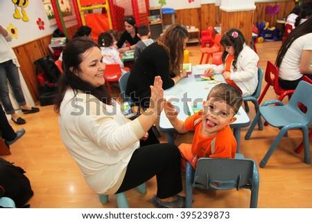 ISTANBUL, TURKEY - APRIL 4: Children learning intelligence games in kindergarten school on April 4, 2014 in Istanbul, Turkey. - stock photo