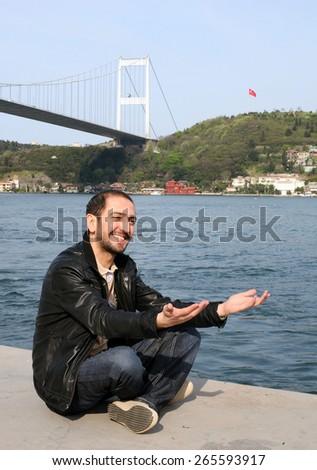 ISTANBUL, TURKEY - APRIL 21: Famous Turkish musician, songwriter and folk singer Ferman Toprak portrait on April 21, 2010 in Istanbul, Turkey. - stock photo