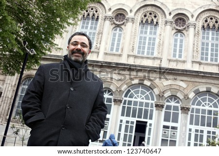 ISTANBUL, TURKEY - APRIL 10: Famous Turkish writer Ahmet Umit at book promotion press meeting on April 10, 2012 in Istanbul, Turkey. Ahmet Umit, Turkey's best selling crime books writer. - stock photo
