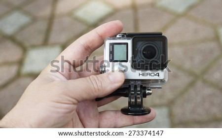 ISTANBUL, TURKEY - APRIL 28 ,2015: Gopro action camera in hand.Shot of GoPro Hero 4 Black.It is a compact, lightweight personal camera manufactured by GoPro Inc. - stock photo