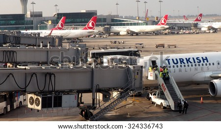 ISTANBUL, TURKEY - August 05, 2015: Airplanes of Turkish Airlines in the Istanbul Ataturk Airport international airport.Loading operations in airport Istanbul Ataturk Airport. - stock photo