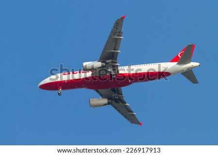 ISTANBUL, TURKEY - AUGUST 17, 2014: Atlasjet Airlines Airbus A320-233 landing to Sabiha Gokcen Airport. Atlasjet have 17 destinations with 18 fleet size. - stock photo