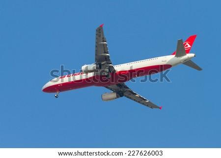 ISTANBUL, TURKEY - AUGUST 17, 2014: Atlasjet Airlines Airbus A321-231 landing to Sabiha Gokcen Airport. Atlasjet have 17 destinations with 18 fleet size. - stock photo