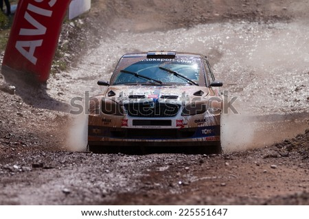 ISTANBUL, TURKEY - AUGUST 17, 2014: Burak Cukurova drives Skoda Fabia S2000 car of Tok Sport WRT in Avis Bosphorus Rally, Gocbeyli Stage - stock photo