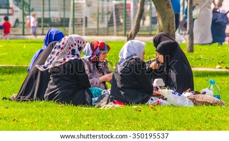 ISTANBUL, TURKEY, AUGUST 17, 2014: Istanbul ladies are having picnic on the shore of golden horn in istanbul, which becomes place for leisure during sunny day - stock photo