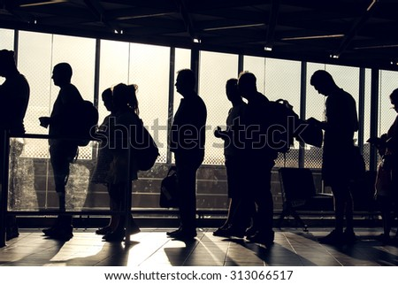 Istanbul, Turkey, August 27, 2015: People are waiting in the Ataturk airport terminal with their silhouette reverse lighted image - stock photo