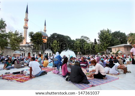 ISTANBUL, TURKEY - AUGUST 8: People waiting The Iftar near the Eyup Sultan Mosque at Ramadan on August 8, 2011 in Turkey. Built in 1458, first mosque constructed by the Ottoman Turks in the city. - stock photo