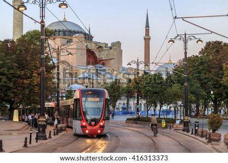 ISTANBUL, TURKEY - August 25 ,2015: People walk in streets of Istanbul at sunset.