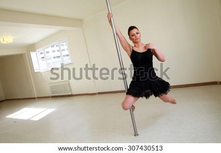 ISTANBUL, TURKEY - AUGUST 25: Pole dancer woman training at dance hall on August 25, 2013 in Istanbul, Turkey. - stock photo