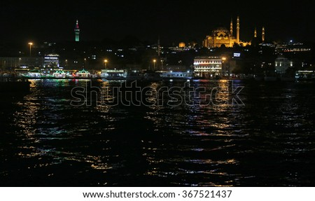 ISTANBUL, TURKEY - AUGUST 13, 2015: The Suleymaniye Mosque and the Golden Horn shot at night.  - stock photo