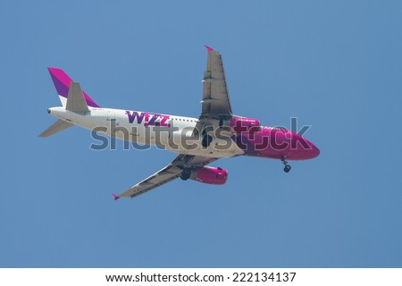 ISTANBUL, TURKEY - AUGUST 16, 2014: Wizz Air Airbus A320-232 landing to Sabiha Gokcen Airport. Wizz Air have 97 destinations in 35 countries with 54 fleet size. - stock photo