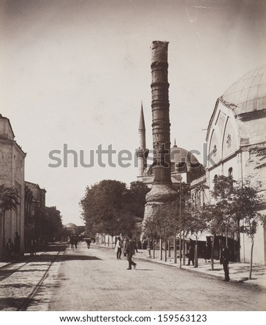 ISTANBUL-Turkey,Circa 1900's :Cityscape in old Istanbul.  Column of Constantine  is a Roman monumental column constructed on the orders of the Roman emperor.Circa 1900's. - stock photo