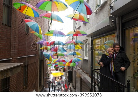 ISTANBUL,TURKEY - DEC 30 : Colorful umbrellas hanging near street cafe on December 30,2015 in Istanbul, Turkey. - stock photo