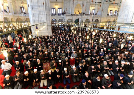 ISTANBUL, TURKEY - DEC 14: noon prayer in congregation male Muslims Fatih Mosque on December 14, 2014 in Istanbul, Turkey. Muslim Prayer is a prayer to the hair they do 5 times a day. - stock photo