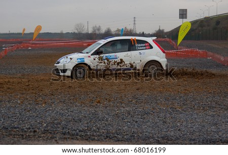 ISTANBUL, TURKEY - DECEMBER 26: Bora Kabatepe drives a  Ford Fiesta ST car during Istanbul Rally Championship, SS Stage on December 26, 2010 in Istanbul, Turkey - stock photo