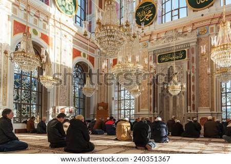 ISTANBUL, TURKEY - DECEMBER 25: Ortakoy Mosque interior.Muslim men praying in a ortakoy mosque inside in Istanbul. DECEMBER 25, 2014 in Istanbul, Turkey . - stock photo