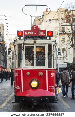ISTANBUL, TURKEY - DECEMBER 23:Taksim Istiklal Street at eventide on December 23, 2014 in Istanbul, Turkey. Taksim Istiklal Street is a popular destination in Istanbul. Nostalgic tram of Istanbul.  - stock photo