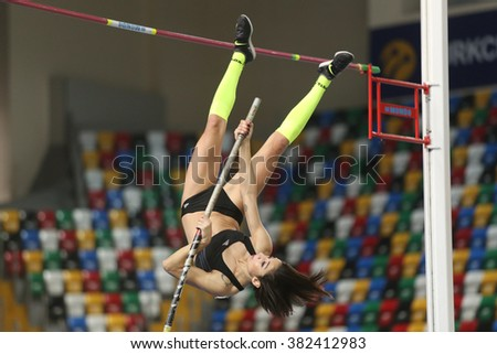 ISTANBUL, TURKEY - FEBRUARY 25, 2016: Athlete Buse Arikazan pole vaulting in Athletics Istanbul Indoor Championships - stock photo