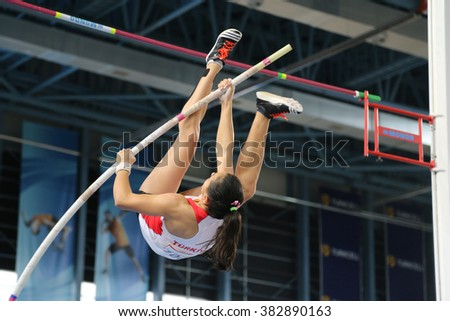ISTANBUL, TURKEY - FEBRUARY 27, 2016: Athlete Demet Parlak pole vaulting in Balkan Athletics Indoor Championships - stock photo