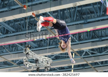 ISTANBUL, TURKEY - FEBRUARY 25, 2016: Athlete Eduard Plotnikov pole vaulting in Athletics Istanbul Indoor Championships - stock photo