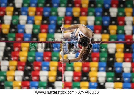 ISTANBUL, TURKEY - FEBRUARY 20, 2016: Athlete Nilan Erdemir pole vaulting during Turkcell Turkish Indoor Athletics Championships - stock photo