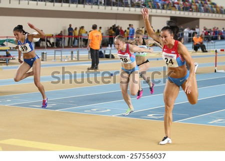 ISTANBUL, TURKEY - FEBRUARY 21, 2015: Athletes running during Balkan Athletics Indoor Championships in Asli Cakir Alptekin Athletics hall. - stock photo
