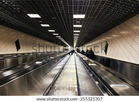 ISTANBUL, TURKEY - FEBRUARY 19, 2015:People on escalator in Marmaray metro. Marmaray, Asia established between the European continent and thesea is passing under the first rail public transport system - stock photo