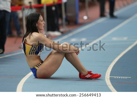 ISTANBUL, TURKEY - FEBRUARY 21, 2015: Rumanian athlete Pastor Adelina after 4x400 relay race during Balkan Athletics Indoor Championships in Asli Cakir Alptekin Athletics hall. - stock photo