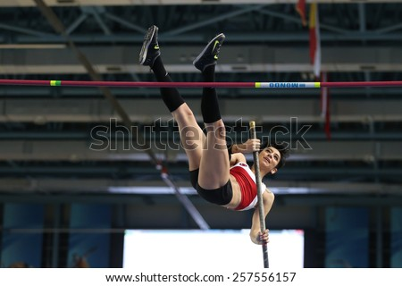 ISTANBUL, TURKEY - FEBRUARY 21, 2015: Turkish athlete Buse Arikazan pole vaulting during Balkan Athletics Indoor Championships in Asli Cakir Alptekin Athletics hall. - stock photo