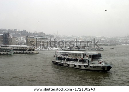 ISTANBUL, TURKEY - JANUARY 23: A snowy day in Eminonu Coastline on January 23, 2007 in Istanbul, Turkey. - stock photo